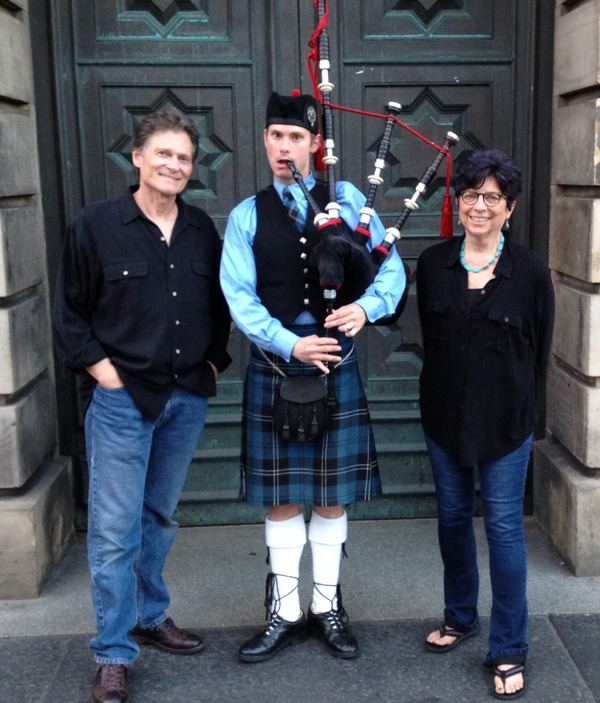 Jan and JD with bagpiper